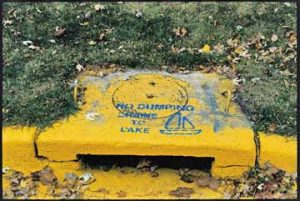 storm sewer labeled to discourage dumping