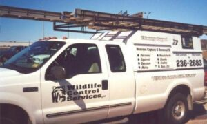 Truck with wildlife control signage